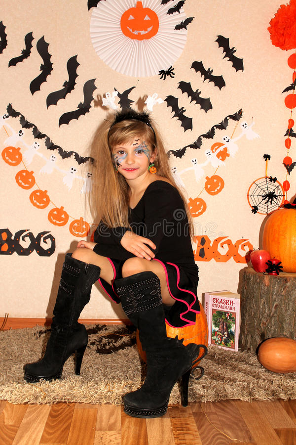 Girl in witch costume on Halloween stock image