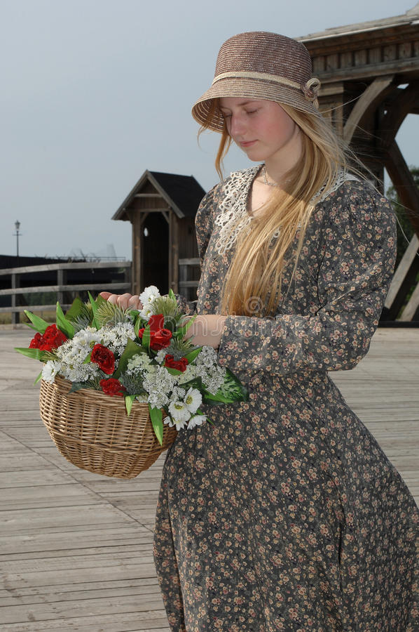 Free Girl With Basket Of Flowers Royalty Free Stock Photography - 11720077