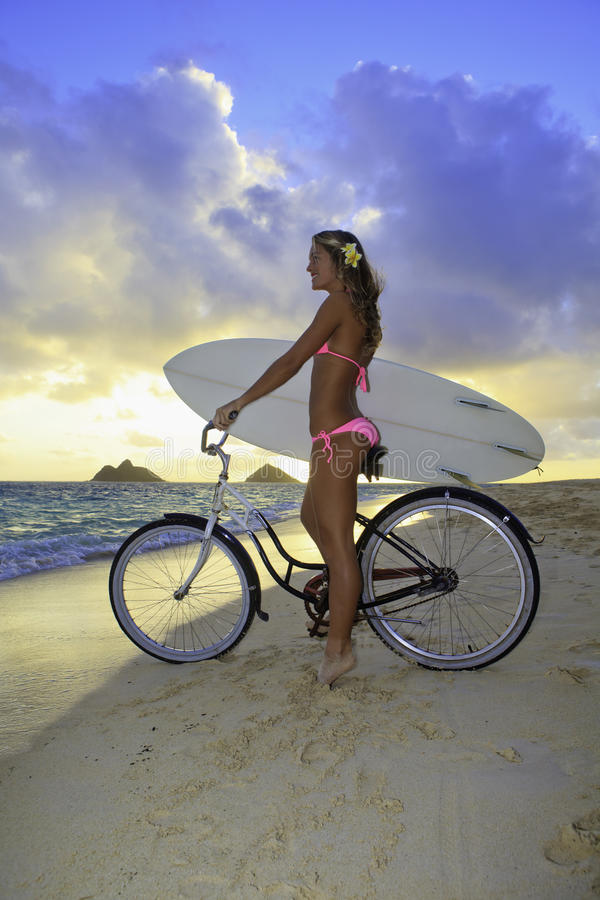 Free Girl With Bike And Surfboard Stock Photo - 17782890