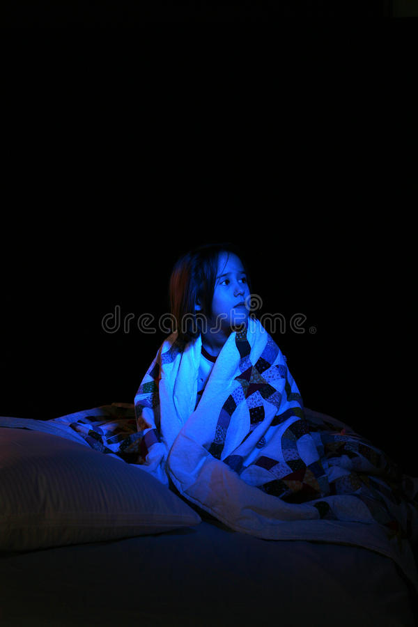 Free Girl With Blue Light As If From TV Royalty Free Stock Photos - 10634308