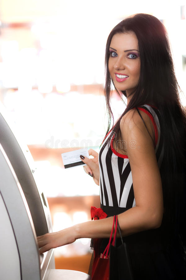 Free Girl With Card And Cash Dispenser Stock Image - 15235451