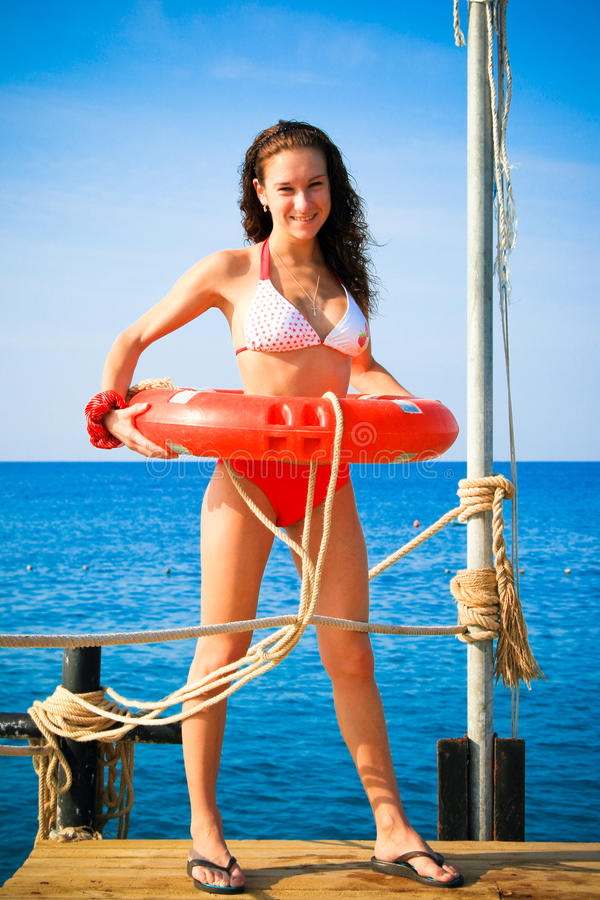 Free Girl With Life Saving Buoy On Pier Royalty Free Stock Images - 11399969