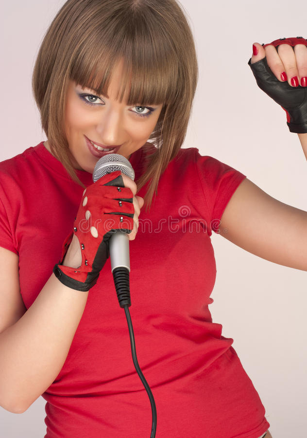 Free Girl With Microphone Royalty Free Stock Image - 13854766