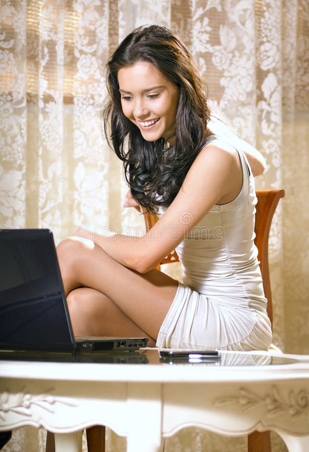 Free Girl With Notebook Computer At Home Stock Photography - 12504552