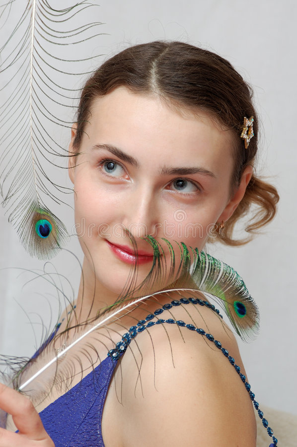 Free Girl With Peacock Feather Stock Image - 4493381