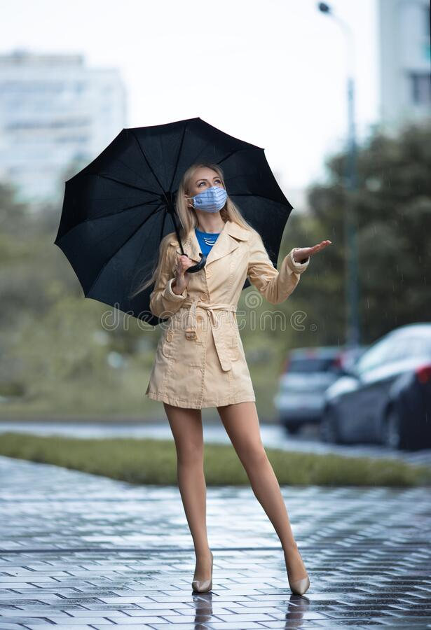 Free Girl With Perfect Legs In Pantyhose With Umbrella Under The Rain Stock Photography - 184120052