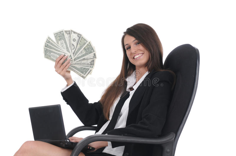 Girl Witn Netbook And Money In Chair Stock Images