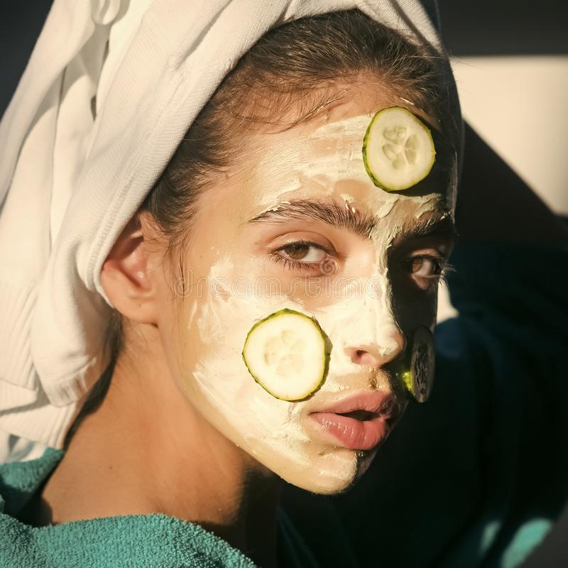 Girl or woman face with cucumber mask, towel on head stock photos