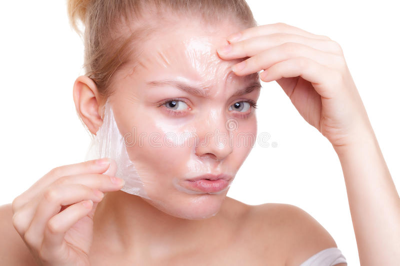Girl woman in facial peel off mask. Skin care. Portrait of girl young woman in facial peel off mask isolated on white. Peeling. Beauty and body skin care royalty free stock photos