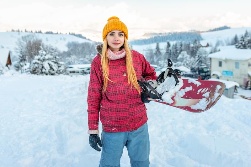 Girl or woman snowboarder in ski equipment outdoor, winter season sport and lifestyle activity royalty free stock photography