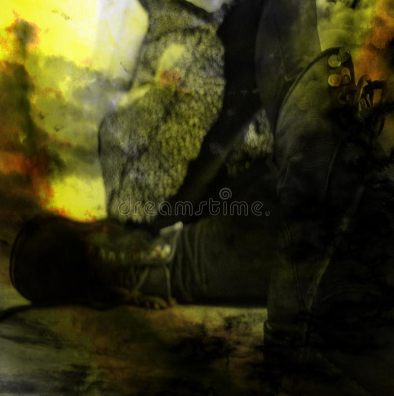 A girl/woman in a dress and black military army boots is sitting on the ground. Abstract blurred background. stock photo