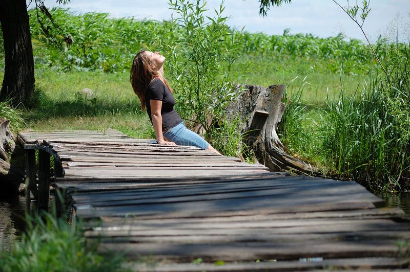 Girl on a wooden bridg stock image