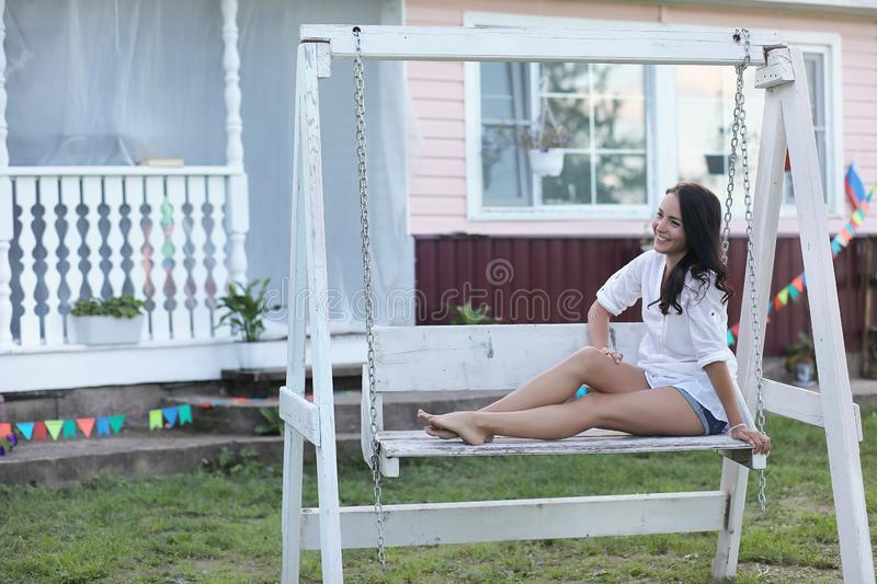 Girl on the wooden porch near the house royalty free stock photo