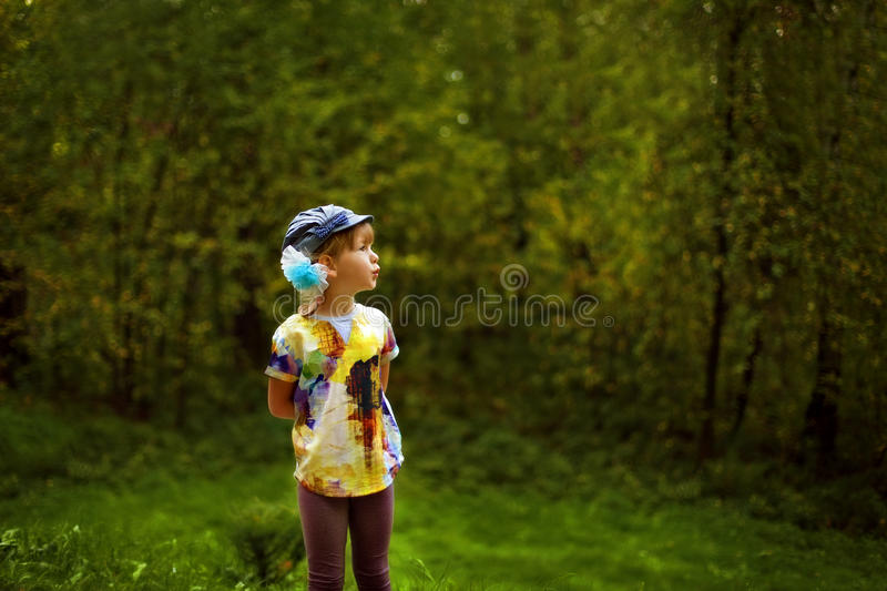 The girl in the woods. Communicating with nature stock images