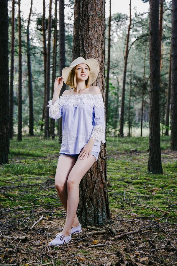 Girl in the woods. royalty free stock image