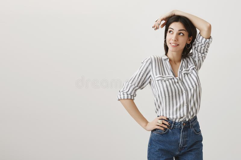 Girl on work looks in sky on airplane, dreaming to fly on vacation. Portrait of attractive stylish woman posing against royalty free stock photography