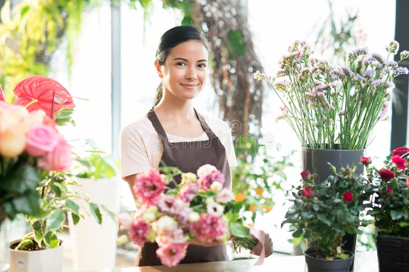 Girl working in florist shop stock photography