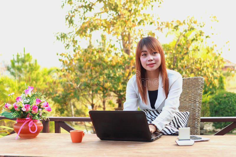 Girl working on her laptop computer outside. On the terrace royalty free stock images