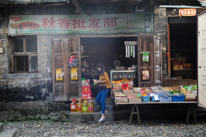 Girl working in her store in Liukeng Village stock images