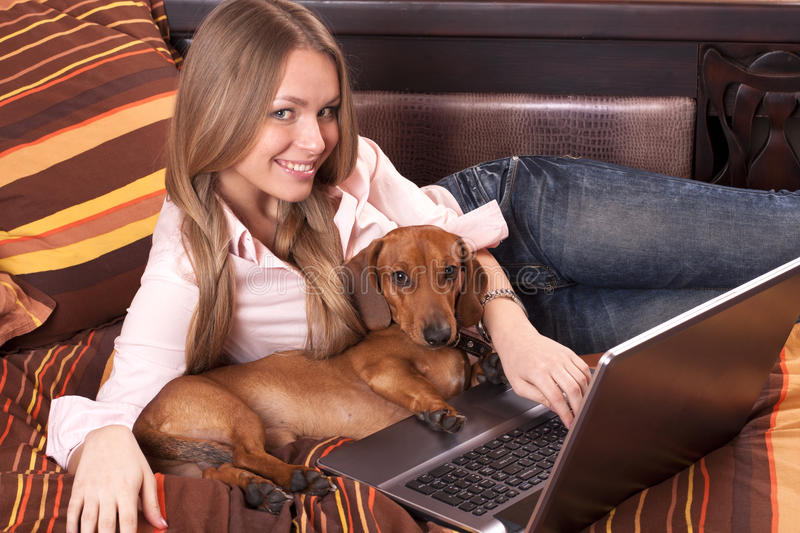 Girl working with laptop royalty free stock images