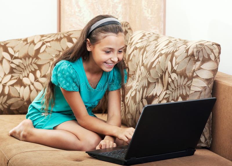 The Girl Is Working On The Laptop Stock Photo