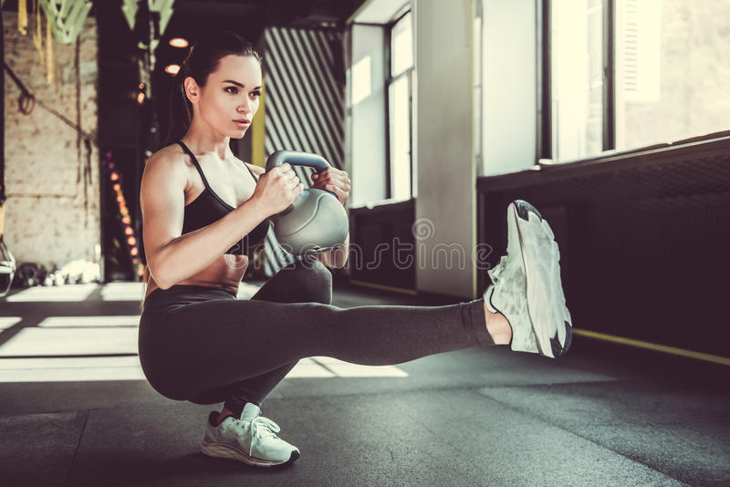Girl working out stock images