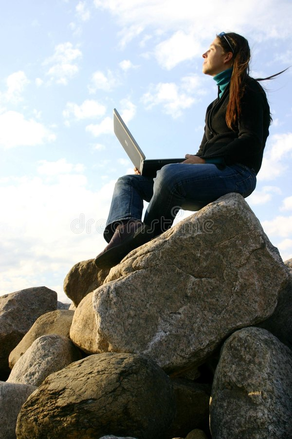 Girl working on top stock images