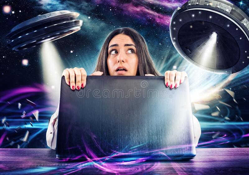 Girl works on the computer surrounded by UFOs. Concept of internet espionage and security royalty free stock image