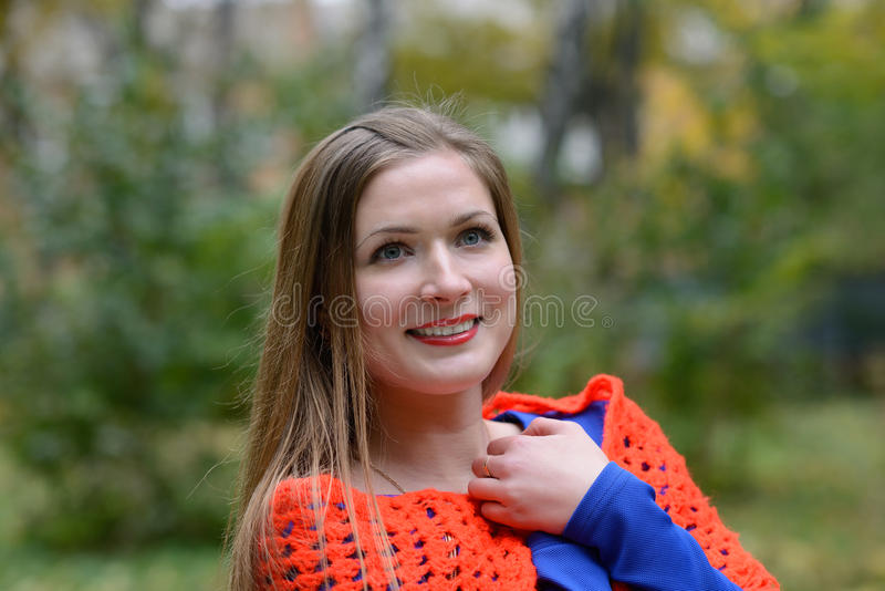 Girl wrapped in a shawl royalty free stock photo