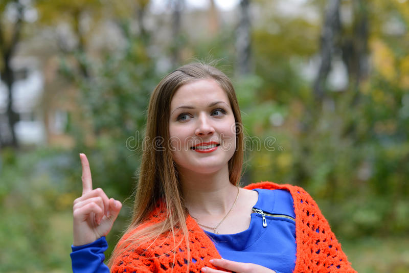 Girl wrapped in a shawl royalty free stock image