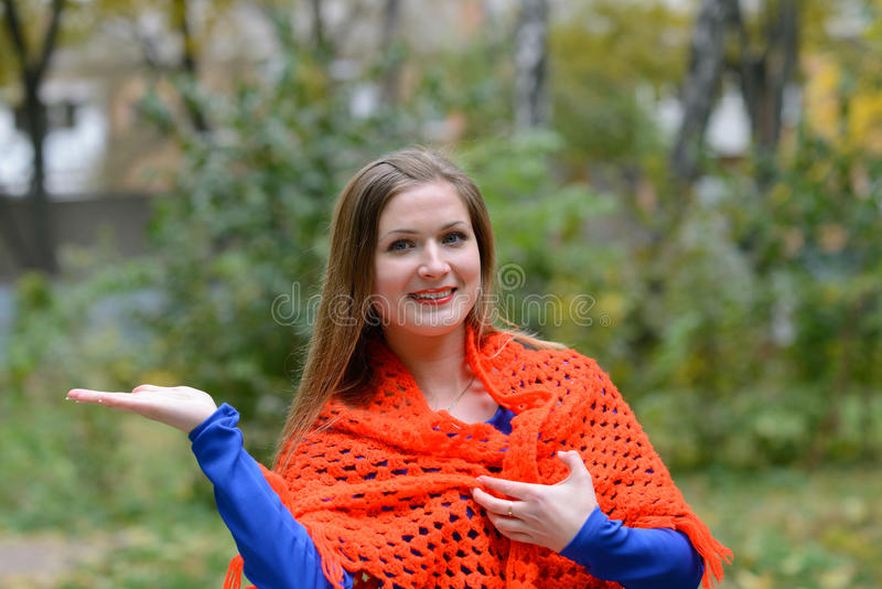 Girl wrapped in a shawl royalty free stock images