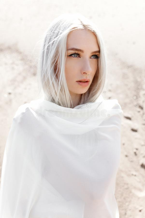 The girl with white hair among the sand mountains royalty free stock photo