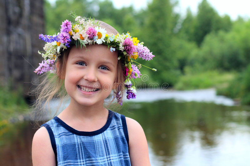 Girl in the wreath royalty free stock image