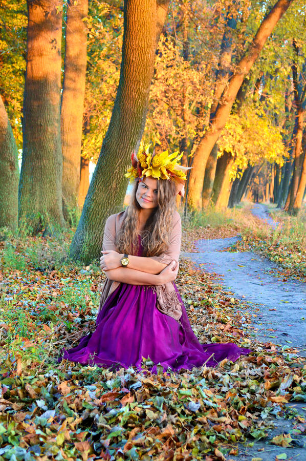 Girl with a wreath autumn landscape stock photography