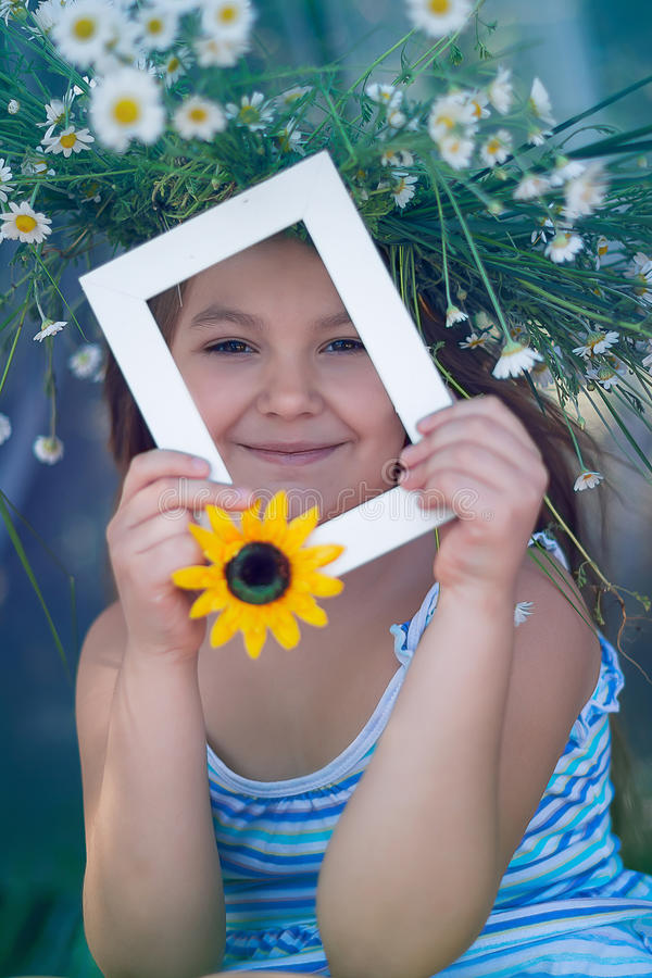 Girl in a wreath of daisies royalty free stock photo