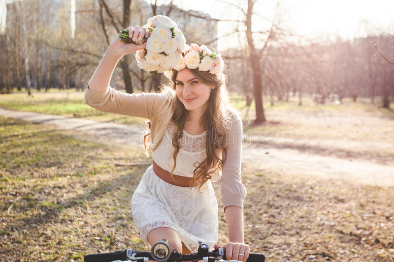 The girl with the wreath on the head by bike stock photos