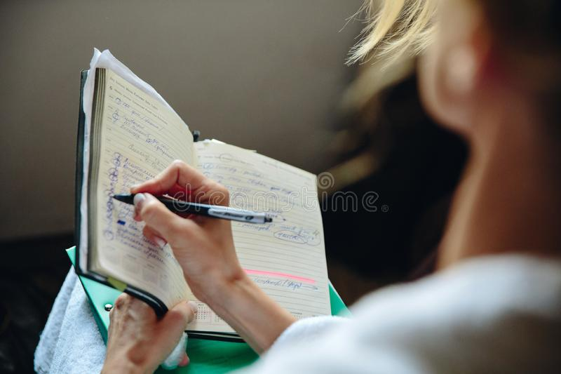 The girl writes the current business on the books stock photos