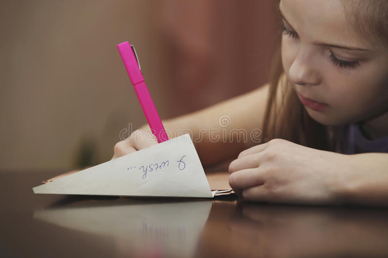 A girl writes a letter royalty free stock photos