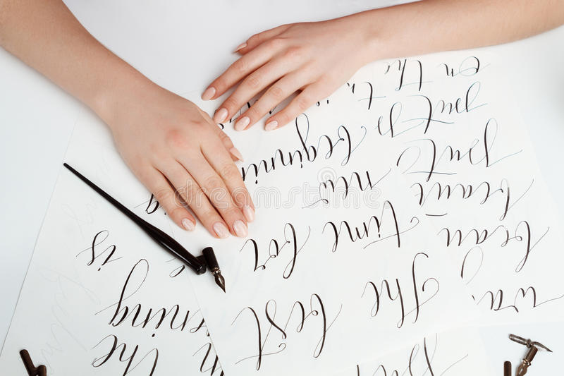 Girl writing calligraphy on postcards. Art design. Above. royalty free stock photos
