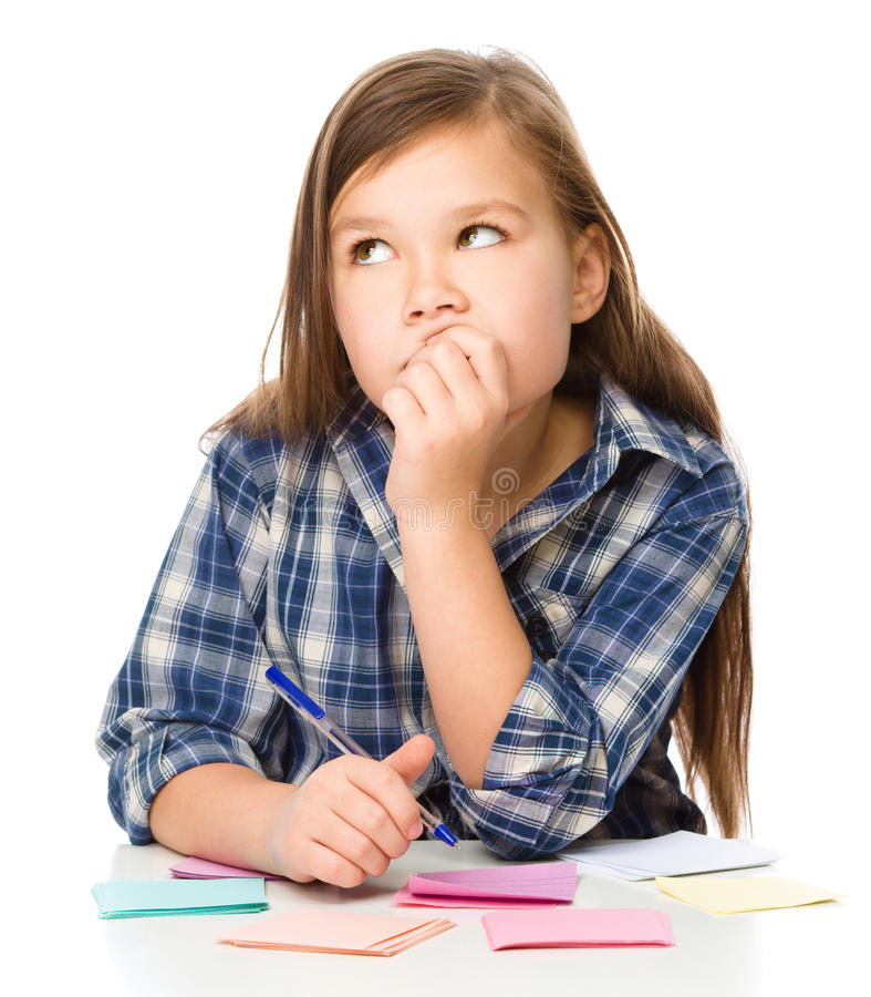 Girl is writing on color stickers using pen. Planning concept, self-organization, isolated over white royalty free stock photos
