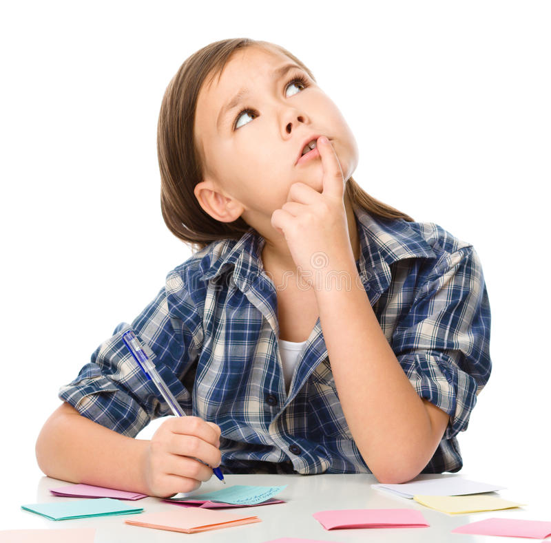 Girl is writing on color stickers using pen. Planning concept, self-organization, isolated over white stock images