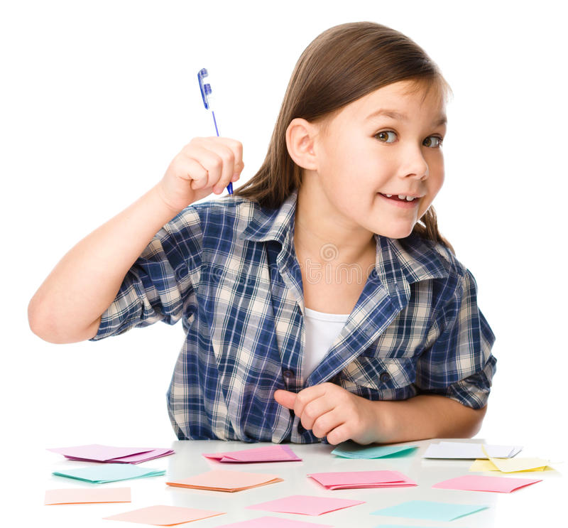 Girl is writing on color stickers using pen. Planning concept, self-organization, isolated over white stock photos