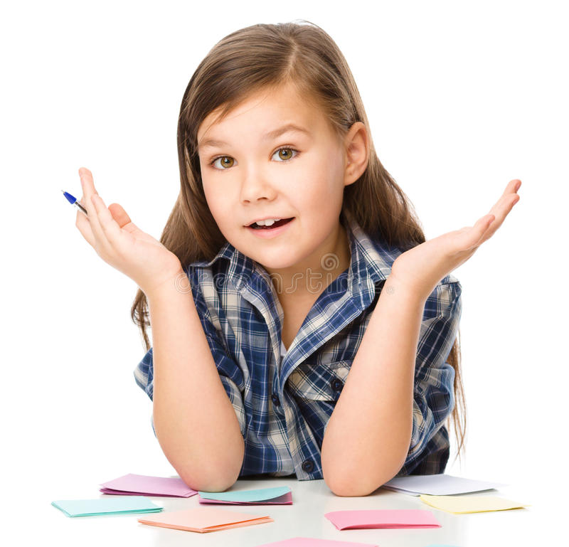 Girl is writing on color stickers using pen. Planning concept, self-organization, isolated over white royalty free stock photography