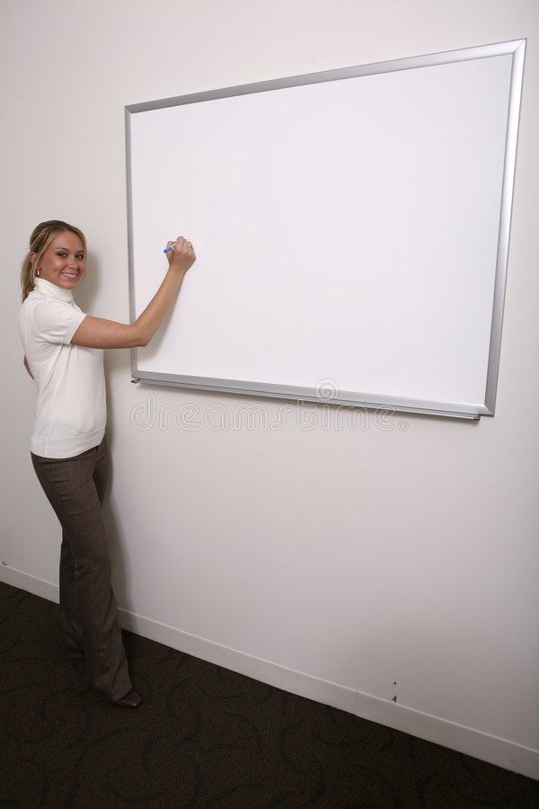 Girl writing on full whiteboard stock images
