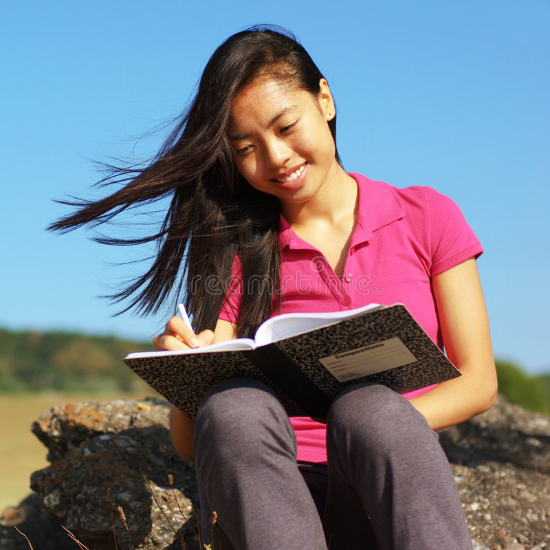 Download Girl Writing in Note Book stock photo. Image of female - 6253694
