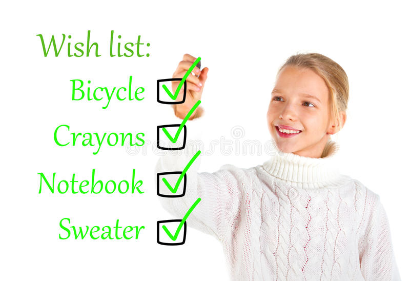 Girl Writing A Wish List Stock Images