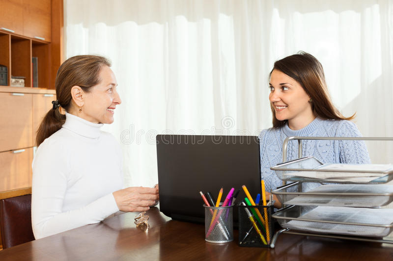 Girl written questionnaire for employee. Of the company at table in office stock photography