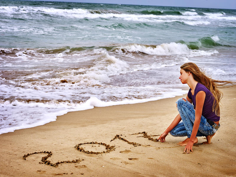 Girl written on sea sand 2016. royalty free stock photography