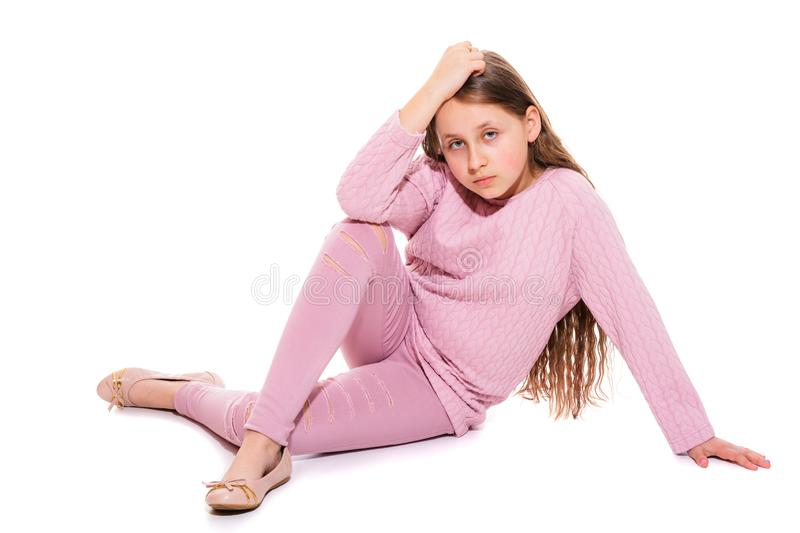 A girl of 10-11 years old with long beautiful hair. Isolation on a white. stock photography