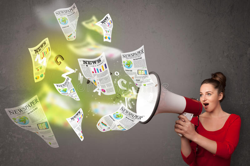 Girl Yelling Into Loudspeaker And Newspapers Fly Out Stock Photo